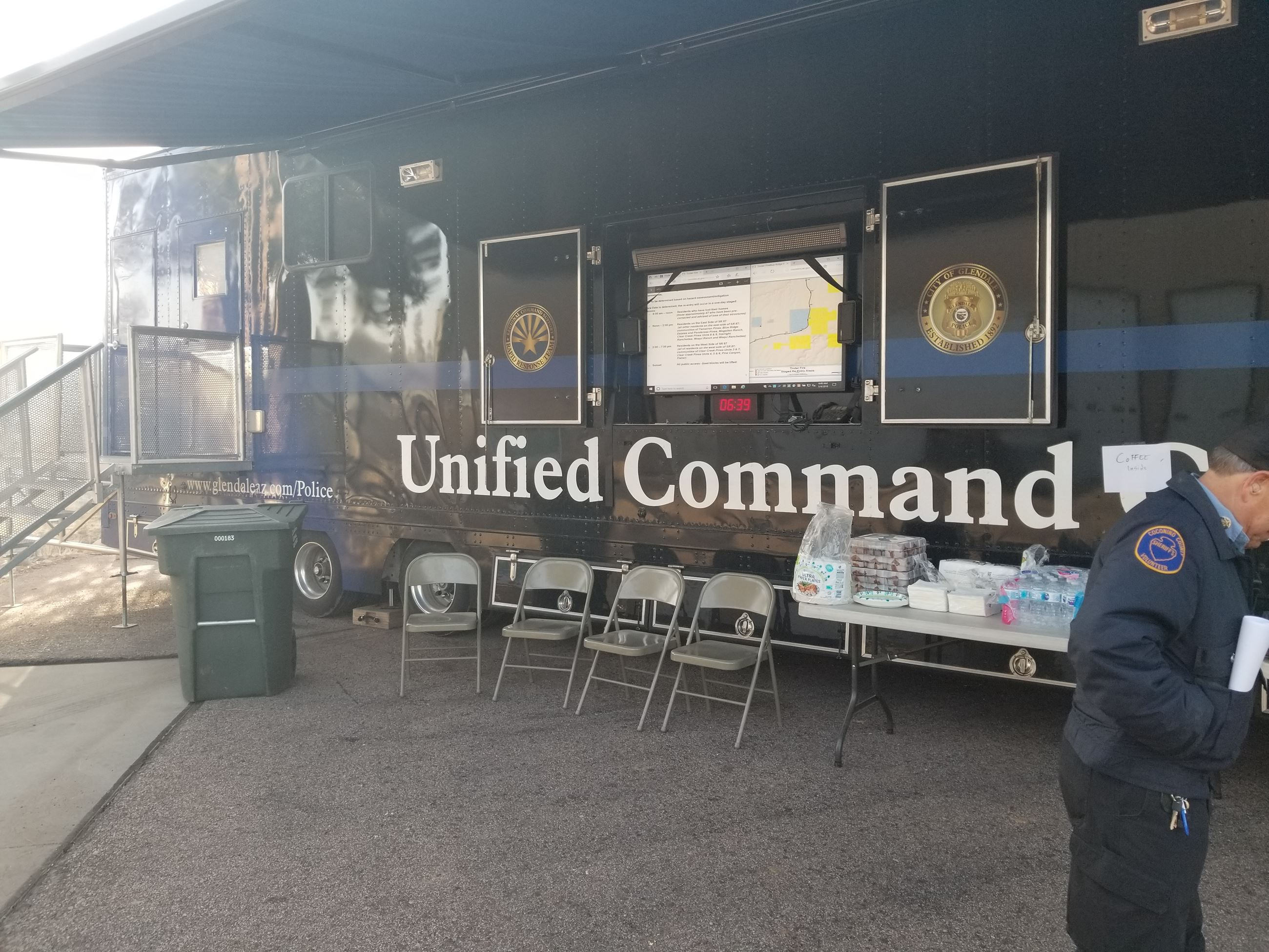 "Blue Ox - a semi tractor trailer command center saying ""Unified Command"" on the side"
