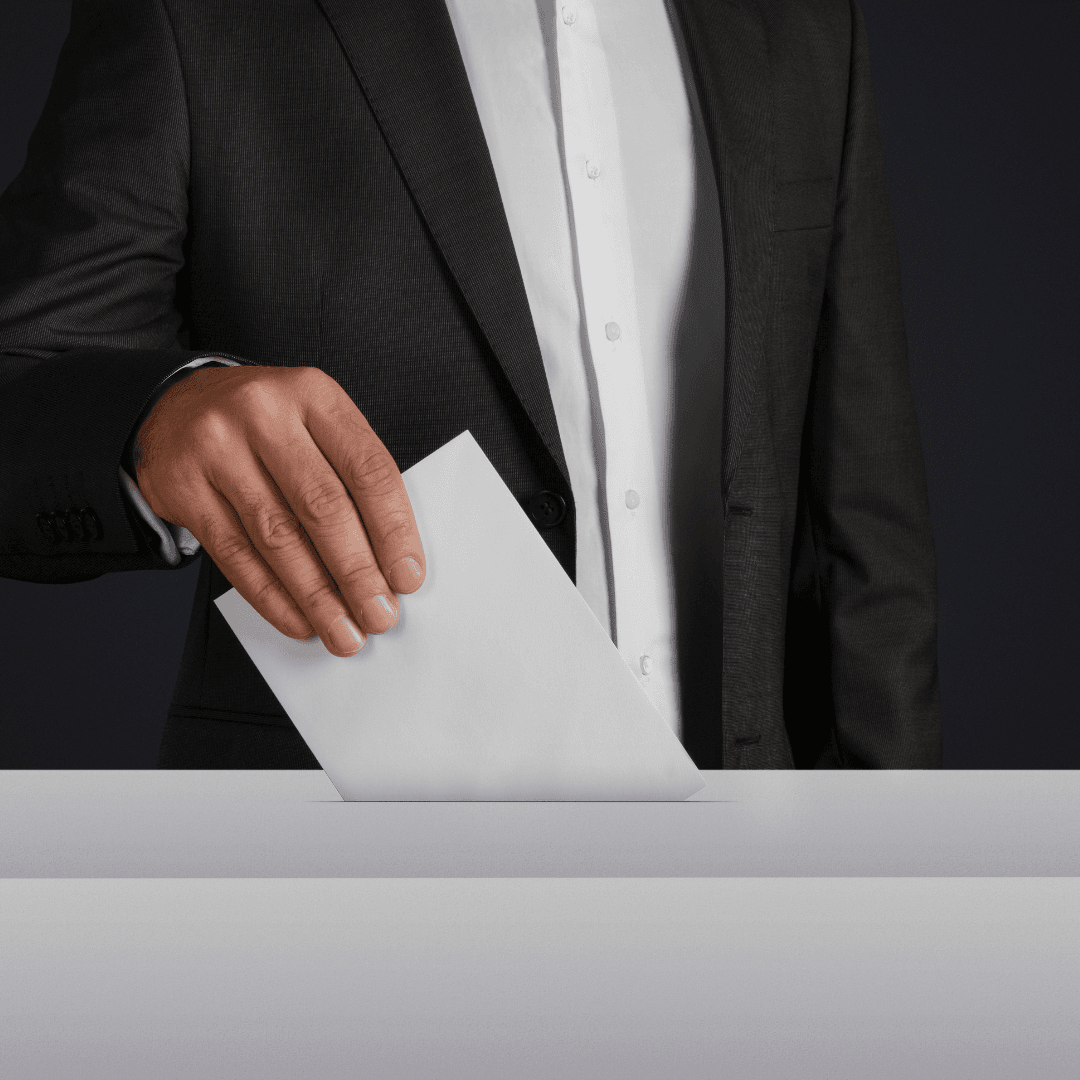 Person in a suit casts ballot