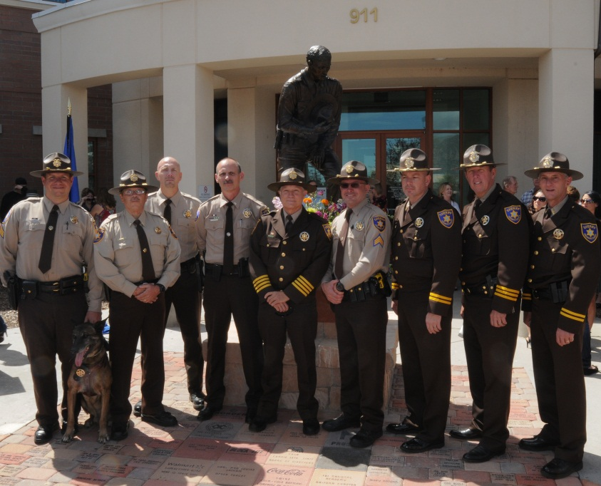 Staff standing in front of Coconino Sheriff Flagstaff Police Law Enforcement Memorial