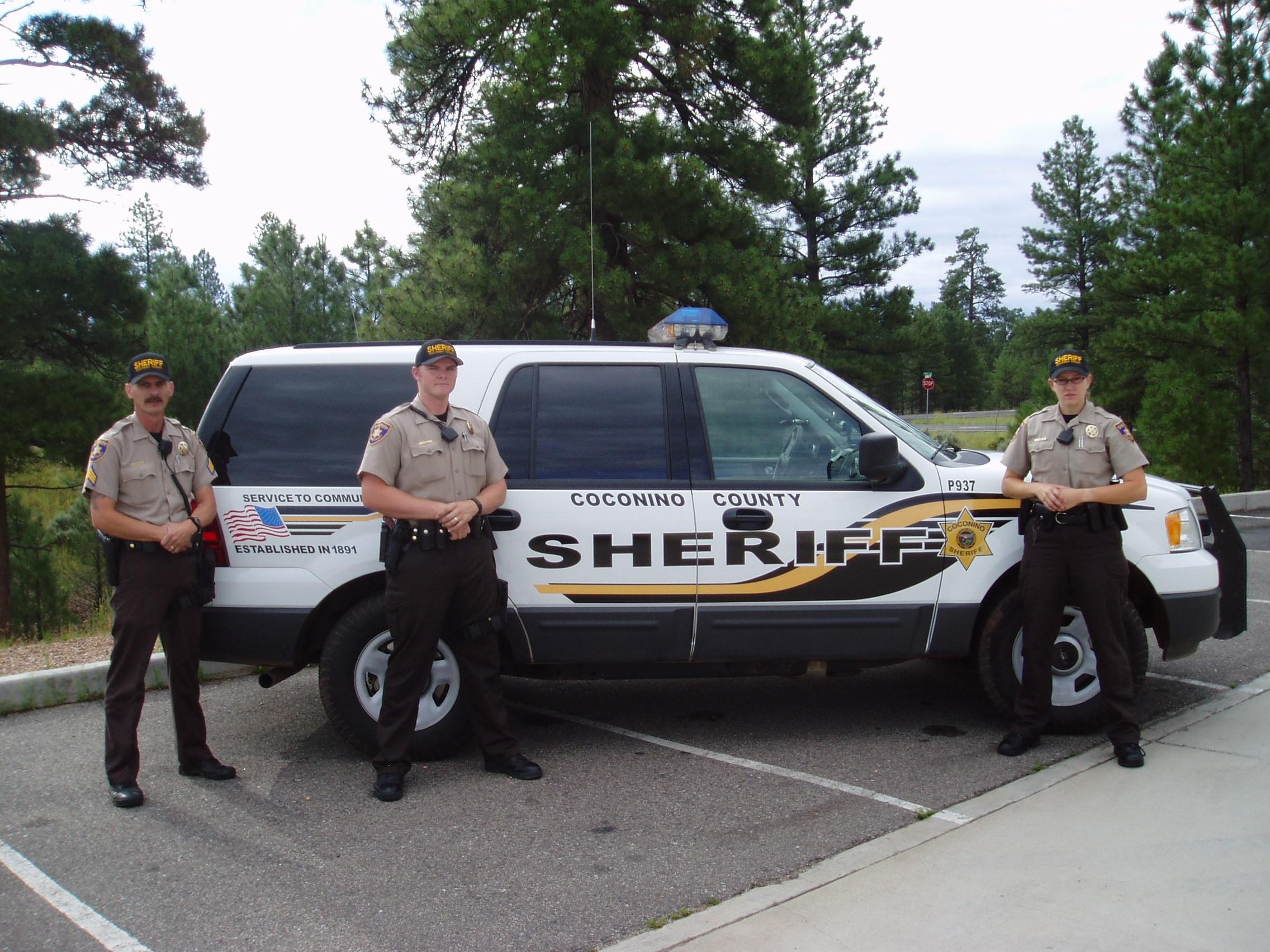 Coconino Sheriff Deputies by patrol vehicle